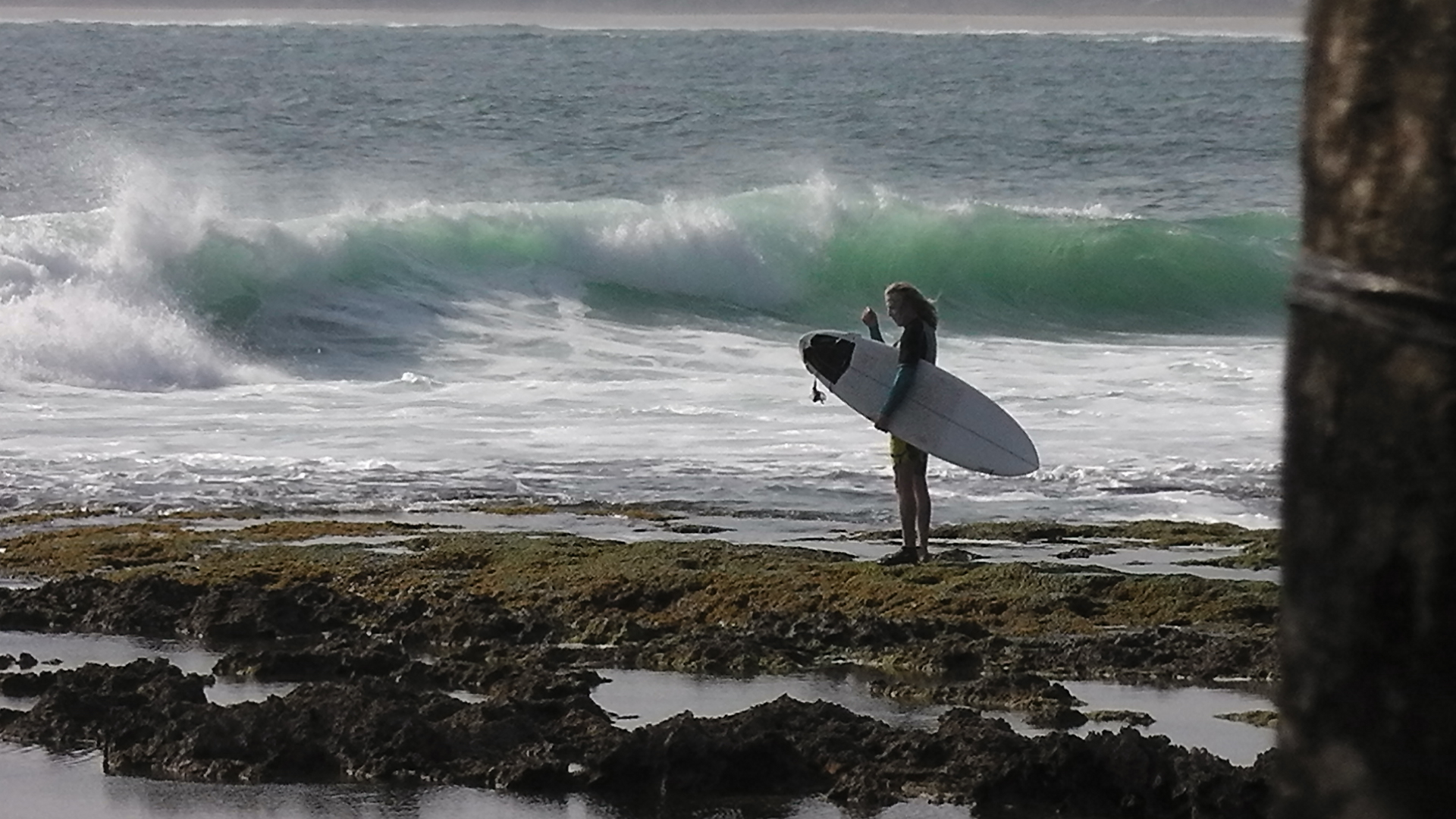 Surfer waiting on a reef